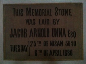 Jacob Unna's foundation stone. It reads 'THIS MEMORIAL STONE WAS LAID BY JACOB ARNOLD UNNA ESQ, TUESDAY | 25th OF NISSAN 5640 6th OF APRIL 1880