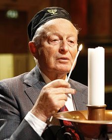 Rudi lighting a Yarhzeit memorial candle on Holocaust Remembrance Day