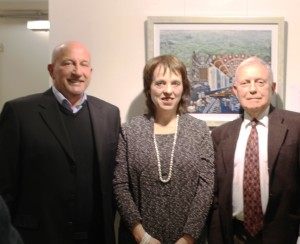 Members of the Bradford Jewish Community In front of the print of depicting Bradford's Jewish connections by artist Beverley-Jane Stewart.